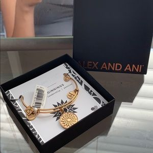 A gold Alex and ani new beginnings bracelet